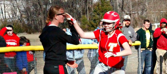 Taylor Lee is congratulated by coach Stephanie Wittman after hitting a three-run home run Thursday against Bishop Ward.