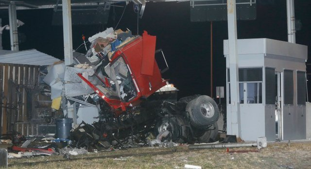 Lawrence Journal-World photo of the damaged toll booth