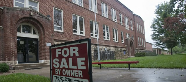 The Baldwin school board approved Tuesday the sale of its remaining buildings and grounds on the north side of the 700 block of Chapel Street to Kansas City developer Tony Krsnich for $90,000. The sale will close today.