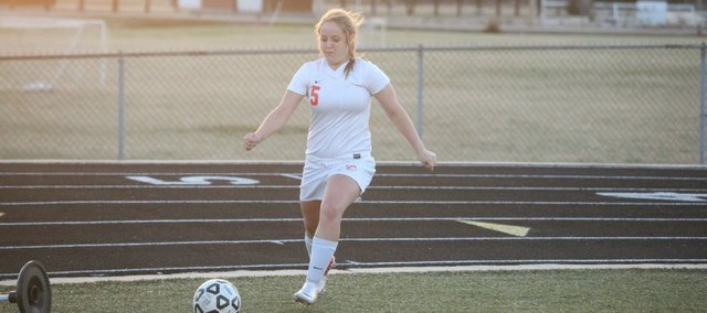 Miyah Hightower takes a corner kick in the second half of Bonner Springs High's 5-0 victory against Tonganoxie High on Monday night. The Lady Braves scored all five goals in the first half, with Hightower netting a hat trick.