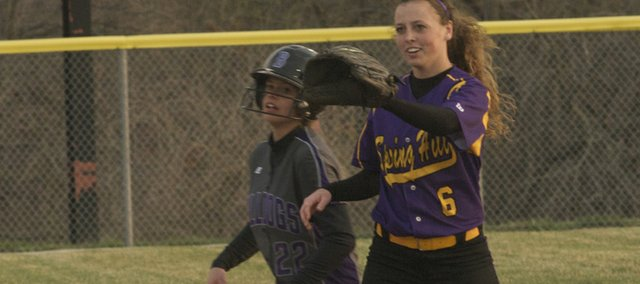 Baldwin sophomore Kylee Bremer beats a throw into second base for a double in the Bulldogs loss in the second game of a doubleheader Tuesday against Spring Hill.