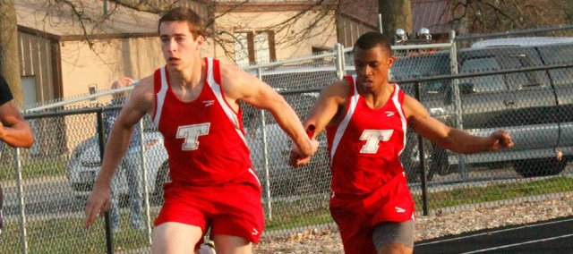 Ben Johnson, left, and Cole Holloway helped the THS boys win a team title Wednesday at the Tonganoxie Invitational.