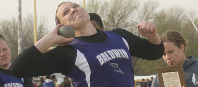 Baldwin High School junior Alexia Stein is chasing the records her former teammate and friend Katie Kehl set last year in the discus and shot put. Stein said Kehl, now competing for Oklahoma State, is encouraging her in the quest.