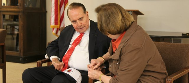 Former Sen. Bob Dole takes photos and chats with local residents April 22 as part of a thank-you tour he's doing throughout Kansas.