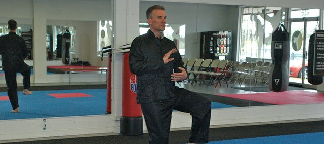 Rick Grimm begins a series of t'ai chi movements. Grimm recently added t'ai chi classes, which he says are great for any age or ability level, at Grand Master Kim's Taekwondo & Fitness in Bonner Springs.