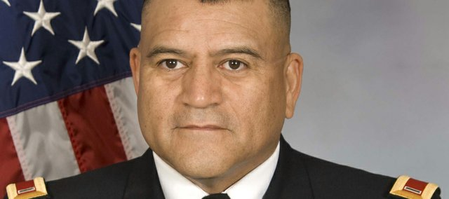 Hector Vasquez, the state command chief warrant officer for the Kansas National Guard, will receive his master's degree in management Saturday at ceremonies on the Baker University campus.