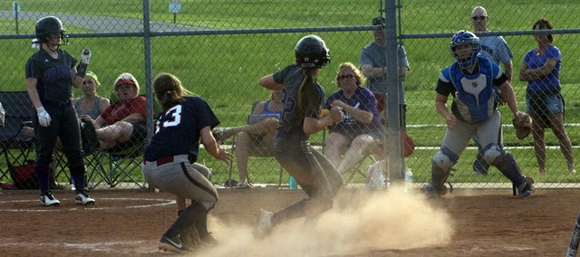 Sophomore Kylee Bremer scores a run for Baldwin in the nightcap of the team's sweep Tuesday of Eudora.
