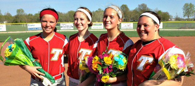 Four Tonganoxie High softball seniors were recognized Friday between games against Spring Hill. Pictured, from left, are Morgan Oroke, Marissa Martin, Caly Ingle-Maxwell and Lainy Walker.