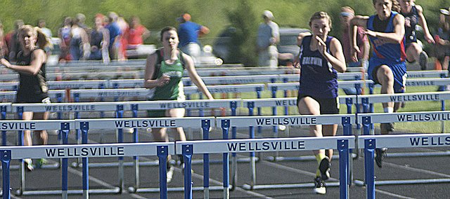 Baldwin junior Maddie Ogle takes the lead in the 100-meter hurdle race last Thursday at the Wellsville Red Bud Classic. Ogle won the race and the 300-meter hurdles, a feat she will attempt to duplicate at today's Frontier League meet at Liston Stadium.