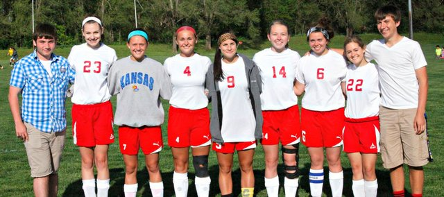 Tonganoxie's soccer seniors were recognized in a ceremony before Tuesday's 7-0 win against Basehor-Linwood. Pictured, from left, are manager Tyler Wehmeyer, Annabelle Frese, Emily Soetaert, Taylar Morgan, Madison Simmons, Alissa Donnelly, Aly Bartholomew, Katie Ebbert and manager Brett Bolon.