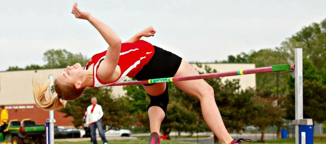 Haley Griffin set new THS and Kaw Valley League meet records Wednesday with a jump of 5 feet, 8 inches.