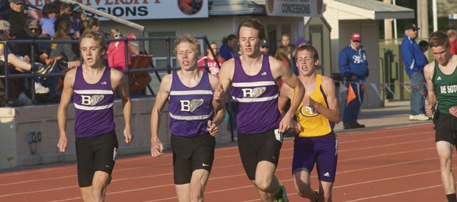 Three Baldwin runners, junior Joe Pierce, left, sophomore George Letner, center, and senior Ethan Hartzell, head to the finish in the 1,600-meter run at Thursday's Frontier League Track and Field Championships at Liston Stadium. Hartzell won the event, with Letner and Pierce finishing second and third, respectively.