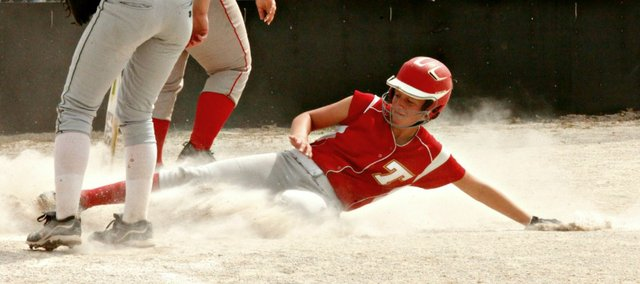 Caly Ingle-Maxwell slides into home plate in Monday's regional semifinal game against Basehor-Linwood. THS fell to the Bobcats, 12-4.