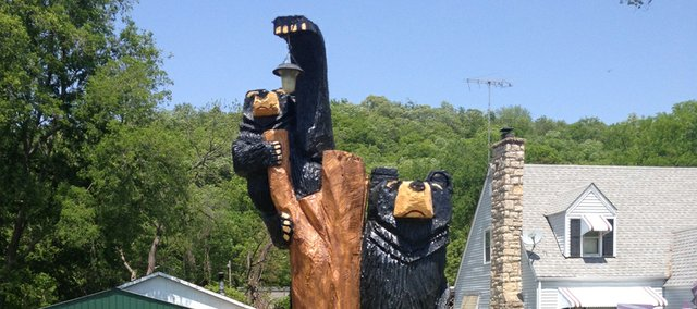 These bears, carved from the trunk of a silver maple tree, preside over the home just east of the Edwardsville city border with Bonner Springs at Lake of the Forest.