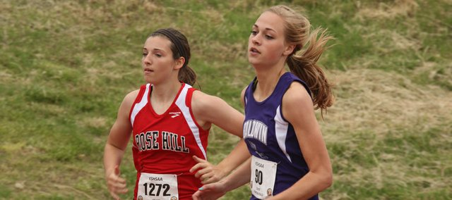Defending 4A 400-meter champion Morgan Lober (right) has adopted a new training routine and attitude in her senior year on the Baldwin High School girls track team.