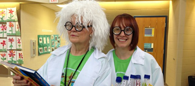 "Librarians Jeanne Dunbar, left, and Lesley Lard portray ""Dr. Fizz"" and ""Beaker"" as they promoted the Bonner Springs City Library's Summer Reading program, ""Fizz, Boom, Read"" at area elementary schools earlier this month."