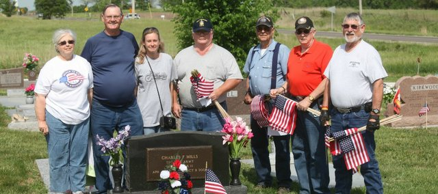 Tonganoxie American Legion Post 41, Legion Riders and Women's Auxiliary members spent Friday morning placing American flags at veterans' graves at Hubbel Hill Cemetery. They later went to Maple Grove and Sacred Heart cemeteries to place flags. Pictured, from left, are Connie Kleinschmidt, Mel Kleinschmidt, Brandi Donnelly, Don Harden, Richard Ogden, Rick Muzzy and Richard Cottam.