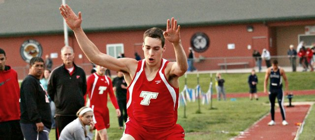 Tonganoxie High senior Ben Johnson won a state title in the triple jump Friday in Wichita.
