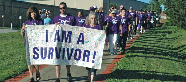 The survivors walk down the hill from Bonner Springs High School to enter the stadium for the 2014 Kaw Valley Relay For Life.