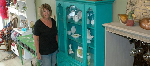 Kathy McBride, co-owner of Garland Taylor Home in Downtown Bonner, said the store will specialize in refurbishing older furniture like this china cabinet.