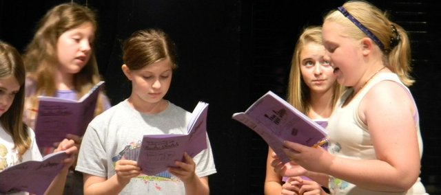 "Tonganoxie area youth rehearse for their production of ""Tom Sawyer"" at the Tonganoxie Performing Arts Center on the Tonganoxie HIgh School campus. The youth theatre group will stage the show Friday and Saturday at the performing arts center."