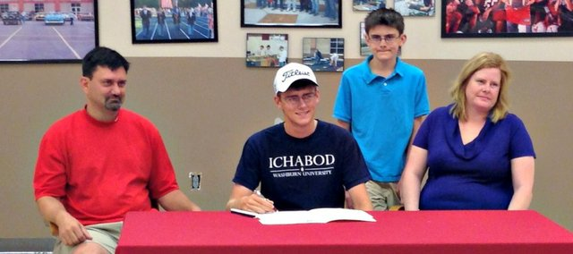 Drew Sandburg, center, will continue his golf career this fall at Washburn University.