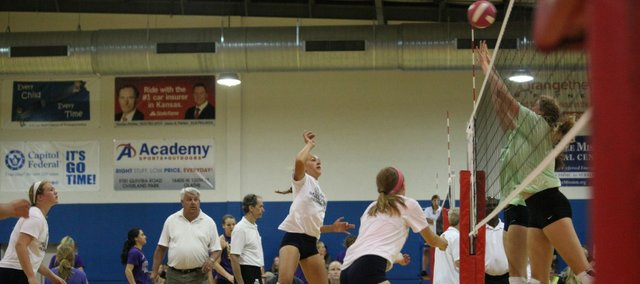 Morgan Thomas floats a ball over St. Thomas Aquinas' blockers on Saturday. Fay is trying to make Thomas a setter because of her quickness and high energy.