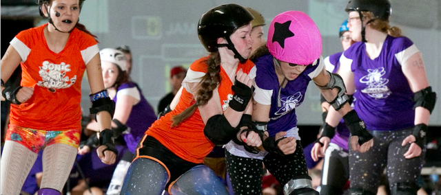 Lauren Murphy, left, blocks the opposing team's jammer. Murphy will skate in her final junior bout on Aug. 24.