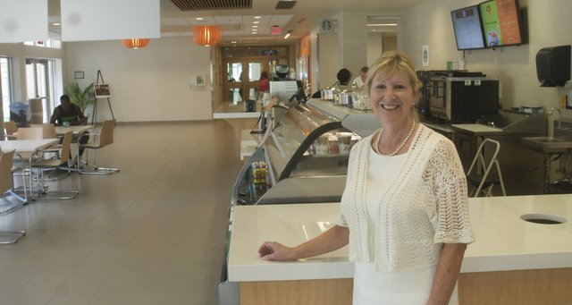Susan Lindahl, Baker University executive vice president of administrative services and chief operation officer, leans against Harter Union's new coffee bar that offers Starbucks coffee and smoothies from Jamba Juice