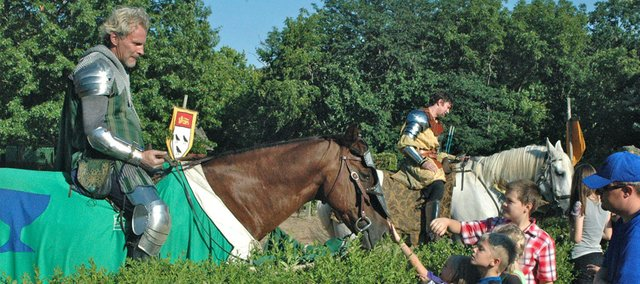 "Visitors come up to pet the horse of ""Sir Arthur"" following the joust during the 2013 season of the Renaissance Festival."