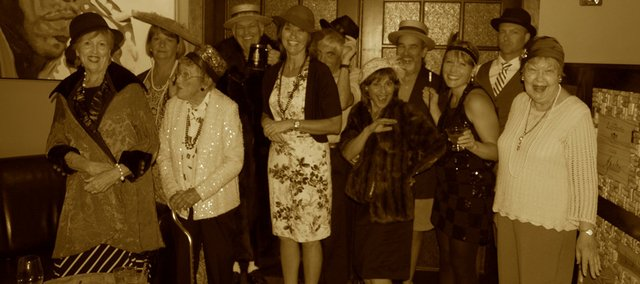 The Bonner Springs Rotary Club members and friends dress up in promotion of their Nov. 1 Speakeasy event, which will benefit Vaughn-Trent and Allegro Choirs.