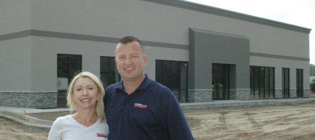 Sandra and Mike Reid will expand their car dealership, Homestead Motors, with a new building just a block to the east. The building's grand opening is set for Sept. 20.