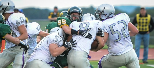 Jared Hiss makes a tackle Friday against Baldwin. Basehor-Linwood defeated the Bulldogs in overtime, 20-17.