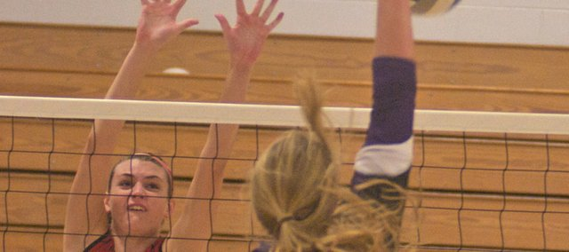 Baldwin's Jordan Hoffman reaches for a kill Saturday against Anderson County as the Bulldogs successfully defended their Wellsville Invitation Tournament title. Hoffman and fellow senior Corey Valentine were named to the all-tournament team.