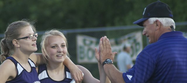Ted Zuzzio, right, congratulates Glenn Kelley McCabe (left) and Elizabeth Sigvaldson after they ran legs of a wining relay at the 2013 Frontier League track meet. Zuzzio, who retired from teaching in June but will continue as BHS girls track coach, was chosen to be the grand marshal Maple Leaf Festival Parade.