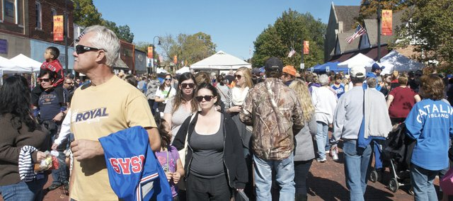 Maple Leaf Festival visitors crowd downtown Baldwin City streets early Saturday afternoon. Festival organizers said the Saturday crowd appeared to be as good as any the festival has had.