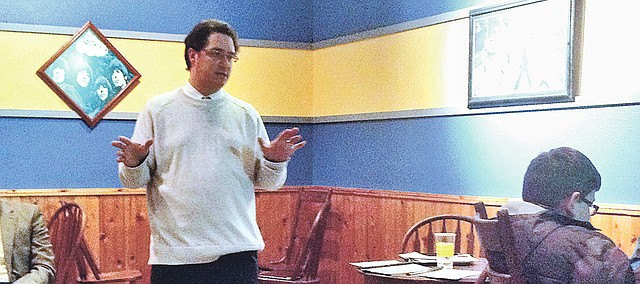 Andrew Nave, executive director of the Shawnee Economic Development Council, speaks to Westbrook Village Shopping Center business owners during a recent brainstorming session regarding ways to make the center thrive.