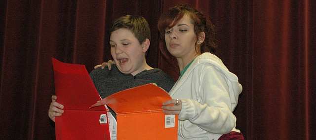 Alec Dill (left) and Makayla Young read from their scripts as they rehearse Tuesday for the BSHS/CMS Drama Club.