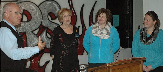 In December, Bonner Springs Rotary Club (from left) treasurer Del Coleman and former president Judy Miksch present checks to Christie Elsner, director of Allegro Childrens Choirs, and Racheal Nickerson, director of Vaughn-Trent Community Services. The club raised $7,000 total for the two organizations at its Speakeasy event Nov. 1.