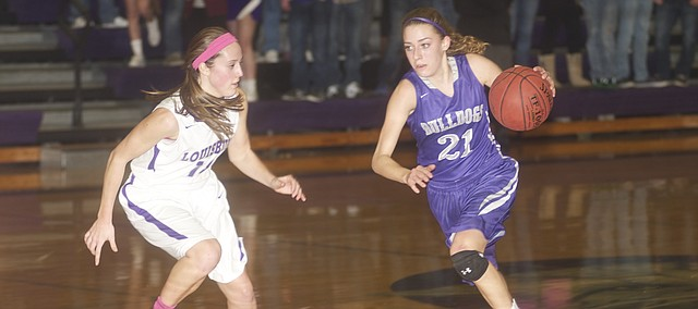 Baldwin junior Madeline Neufeld drives against a Louisburg defender in Tuesday's Bulldog 44-28 road victory. Neufeld and her teammates pulled away from the Wildcats when they give up just two points in the fourth quarter.