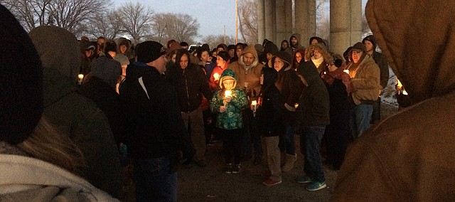 Local residents gather for a prayer vigil Thursday evening to honor Colin Bennett, a 2012 Tonganoxie High School graduate who died in a vehicle accident early Thursday.
