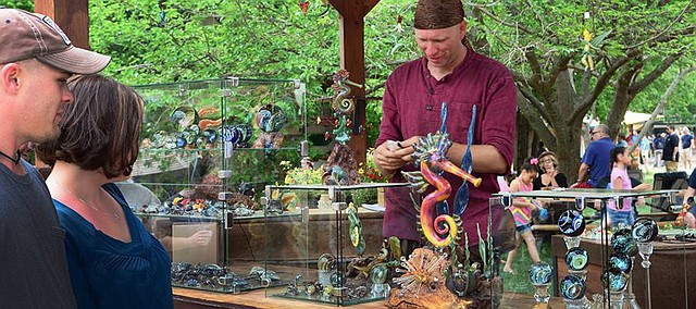 Raven Copeland sells his wares at one of five annual Rennaissance Faires he attends each year as a vendor. Copeland, currently based in Texas, will bring his artwork to Moon Marble Co.'s 15th Annual Marble Crazy in Bonner Springs for the first time this weekend.