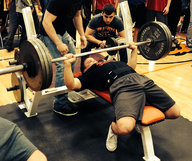 Seth Wolf lifts in the bench press during Saturday's Class 4A state powerlifting championships. The senior borke the state record in his weight division with a successful lift of 325 pounds.