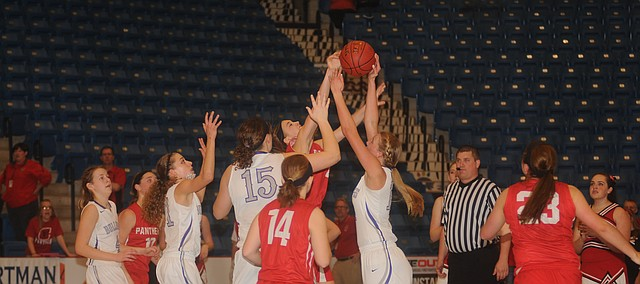 Baldwin senior Corey Valentine blocks a shot in the lane in the Bulldogs' 67-42 victory against Concordia in the semifinals of the 4A Division 2 state tournament. Baldwin, now 21-3 on the year, will play Hugoton, 21-2, for the title at 4 p.m. Saturday.