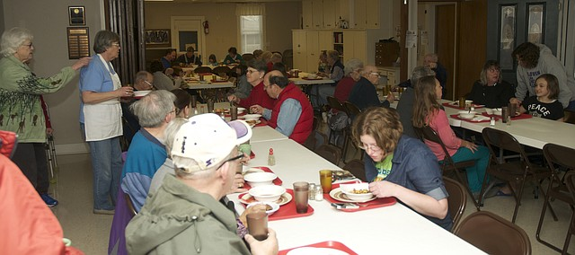 Baldwin City residents enjoy a meal and fellowship Thursday at a free community meal an the Ives Chapel Fellowship Hall. The church will continue providing the free meal to all comers the last Thursday of each month, which it started in January.