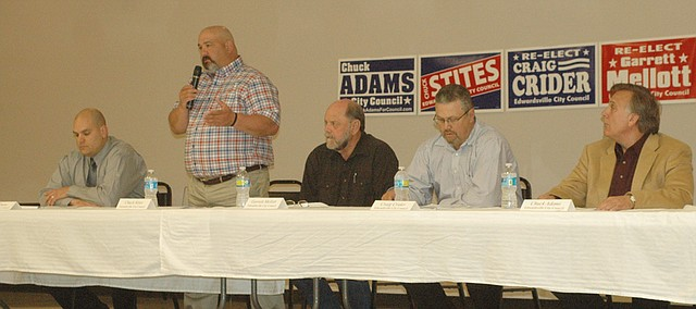 Edwardsville City Council candidate Chuck Stites (standing) speaks at the March 26 candidate forum, as fellow candidates (seated, from left) Terrence Dunn and incumbents Garrett Mellott, Craig Crider and Chuck Adams listen. The five candidates are running for three at-large seats on the council.