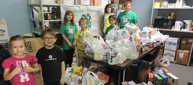 The Brauer Beavers 4-H Club from Bonner Springs helped raise $150 cash donations and 325 pounds of food donations for Vaughn-Trent on March 29 at Price Chopper in Bonner Springs. Above, members in the club pose after they helped drop the donations off at Vaughn-Trent (left to right) Annalee Morche, Justin Korgol, Hazelbell Morche, Danny Morche, Braden Korgol, Kameron Zimmerly and Kamren Brown.