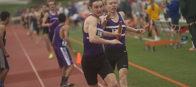George Letner hands off to fellow Baldwin junior Nevin Dunn in the 4-by-800 meter relay. The Baldwin team won the event.