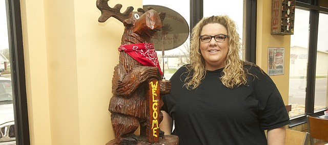 After four years of building a customer base from mobile units, Angela and Moose Barnhart opened Moose's Backwoods BBQ Tuesday in the SantaFe Market.