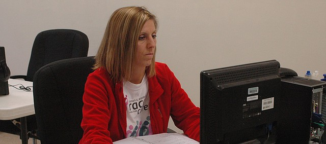 Teri Richert of Edwardsville works at one of the computer stations at the Kaw Valley Learning Center in Bonner Springs, a free program that allows adults to complete their high school diplomas through the Bonner Springs-Edwardsville or Piper school districts.
